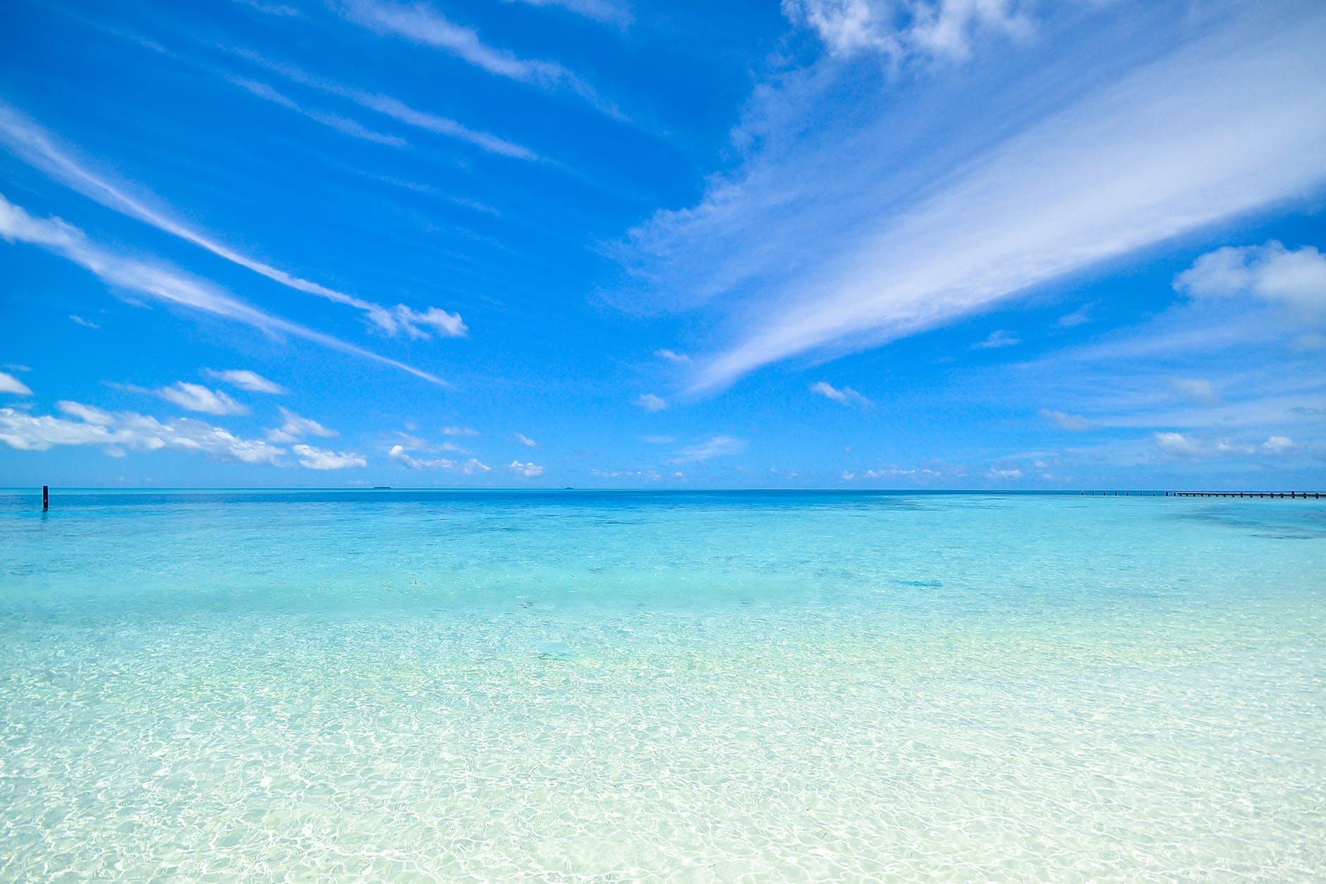 beach calm clouds coast